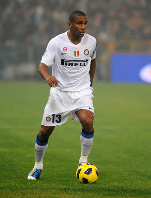 GENOA, ITALY - OCTOBER 29: Sisenando Maicon Douglas of FC Internazionale Milano with the ball during the Serie A match between Genoa CFC and FC Inter Milan at Stadio Luigi Ferraris on October 29, 2010 in Genoa, Italy. (Photo by Massimo Cebrelli/Getty Imag