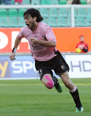 PALERMO, ITALY - NOVEMBER 14:  Javier Pastore of Palermo celebrates after scoring the opening goal during the Serie A match between Palermo and Catania at Stadio Renzo Barbera on November 14, 2010 in Palermo, Italy.  (Photo by Tullio M. Puglia/Getty Image