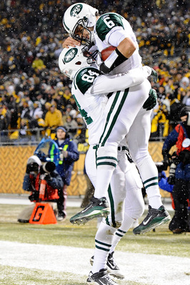 PITTSBURGH, PA - DECEMBER 19:  Mark Sanchez #6 and Ben Hartsock #84 of the New York Jets celebrate after Sanchez ran for a touchdown during their game against Pittsburgh Steelers at Heinz Field on December 19, 2010 in Pittsburgh, Pennsylvania.  (Photo by
