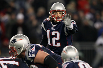FOXBORO, MA - DECEMBER 19:  Quarterback Tom Brady #12 of the New England Patriots talks to his team during the fourth quarter of the game against the Green Bay Packers at Gillette Stadium on December 19, 2010 in Foxboro, Massachusetts. The Patriots won th