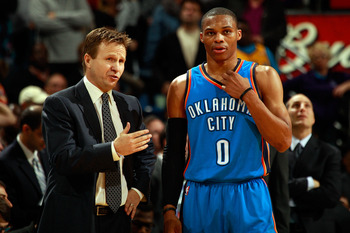 NEW ORLEANS, LA - DECEMBER 10:  Head coach Scott Brooks talks with Russell Westbrook #0 of the Oklahoma City Thunder during the game against the New Orleans Hornets at New Orleans Arena on December 10, 2010 in New Orleans, Louisiana.    NOTE TO USER: User