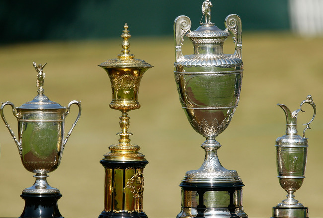 ATLANTA - SEPTEMBER 23:  (L-R) The U.S. Open trophy, U.S. Amateur trophy, British Amateur trophy and British Open trophy are seen in honor of Bobby Jones' 1930 Grand Slam during the opening ceremony prior to the first round of THE TOUR Championship presen