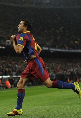 BARCELONA, SPAIN - NOVEMBER 29:  Xavi Hernandez of Barcelona celebrates after scoring the first goal during the La Liga match between Barcelona and Real Madrid at the Camp Nou Stadium on November 29, 2010 in Barcelona, Spain.  (Photo by David Ramos/Getty