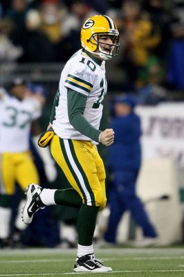 FOXBORO, MA - DECEMBER 19:  Quarterback Matt Flynn #10 of the Green Bay Packers celebrates after passing to wide receiver James Jones #89 (not pictured) who ran 66 yards to score a touchdown in the second quarter against the New England Patriots at Gillet