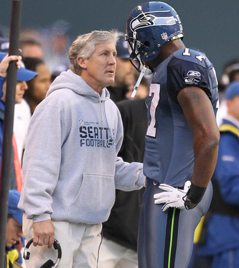SEATTLE, WA - DECEMBER 19:  Head coach Pete Carroll of the Seattle Seahawks talks to wide receiver Mike Williams #17 during the game against the Atlanta Falcons at Qwest Field on December 19, 2010 in Seattle, Washington. (Photo by Otto Greule Jr/Getty Ima