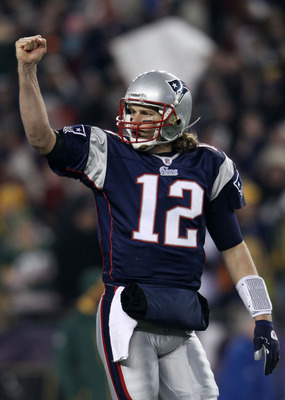 FOXBORO, MA - DECEMBER 19:  Quarterback Tom Brady #12 of the New England Patriots celebrates a touchdown scored by running back BenJarvus Green-Ellis #42 (not pictured) against the Green Bay Packers in the first quarter of the game at Gillette Stadium on