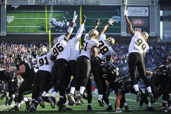 BALTIMORE, MD - DECEMBER 19:  The New Orleans Saints defensive line tries to block a field goal during the game against the Baltimore Ravens  at M&T Bank Stadium on December 19, 2010 in Baltimore, Maryland. The Ravens defeated the Saints 30-24. (Photo by