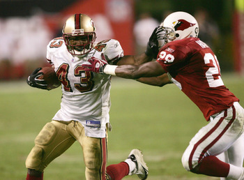TEMPE, AZ - DECEMBER 12:  Running back Maurice Hicks #43 of the San Francisco 49ers breaks carries the ball to set up the winning field goal as defensive back Duane Starks #29 of the Arizona Cardinalsdefends  on December 12, 2004 at Sun Devil Stadium in T