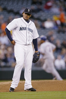 SEATTLE - APRIL 18:  Felix Hernandez #34 of the Seattle Mariners stands on the mound after giving up a home run against the Texas Rangers on April 18, 2006 at Safeco Field in Seattle, Washington. The Rangers defeated the Mariners 7-4.  (Photo by Otto Greu