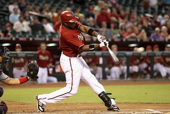 PHOENIX - AUGUST 04:  Justin Upton #24 of the Arizona Diamondbacks hits a RBI single against the Washington Nationals during the first inning of the Major League Baseball game at Chase Field on August 4, 2010 in Phoenix, Arizona.  (Photo by Christian Pete