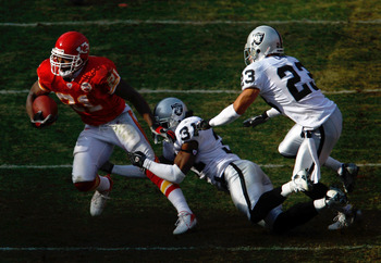 KANSAS CITY, MO - NOVEMBER 25:  Kolby Smith #21 of the Kansas City Chiefs carries the ball as Hiram Eugene #31 and Chris Carr #23 of the Oakland Raiders defend during the game on November 25, 2007 at Arrowhead Stadium in Kansas City, Missouri.  (Photo by