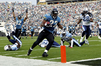 JACKSONVILLE, FL - JANUARY 1:  Running back LaBrandon Toefield #22 of the Jacksonville Jaguars scores a touchdown in the first quarter against the Tennessee Titans at Alltel Stadium on January 1, 2006 in Jacksonville, Florida. (Photo by Doug Benc/Getty Im