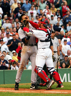 BOSTON - JULY 24:  Alex Rodriguez #13 of the New York Yankees gets into a fight with catcher Jason Varitek #33 of the Boston Red Sox after Rodriguez was hit by a pitch in the third inning on July 24, 2004 at Fenway Park in Boston, Massachusetts.  (Photo b