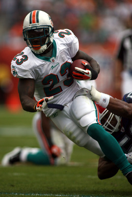 MIAMI - DECEMBER 19:  Running back Ronnie Brown #23 of the Miami Dolphins is upended by the Buffalo Bills at Sun Life Stadium on December 19, 2010 in Miami, Florida.  (Photo by Marc Serota/Getty Images)