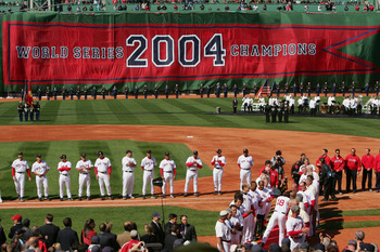 BOSTON - APRIL 11:  The Boston Red Sox celebrate their 2004 World Series Championship during a pre-game ceremony prior to the game against the New York Yankees at Fenway Park on April 11, 2005 in Boston, Massachusetts. The Red Sox won 8-1.  (Photo by Ezra