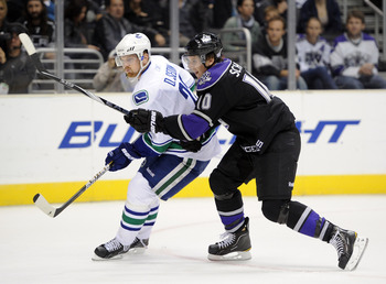 LOS ANGELES, CA - OCTOBER 15:  Brayden Schenn #10 of the Los Angeles Kings defends Daniel Sedin #22 of the Vancouver Canucks at the Staples Center on October 15, 2010 in Los Angeles, California.  (Photo by Harry How/Getty Images)