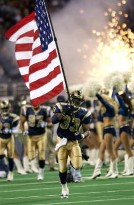 26 Nov 2001 : Justin Watson #33 of the St.Louis Rams carries a flag as he enters the field during pre-game ceremonies at the game against the Tampa Bay Buccaneers at the Dome at the America's Center in St.Louis, Missouri. The buccaneers won 24 - 17. DIGIT
