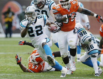 CLEVELAND - DECEMBER 1: Dee Brown #22 of the Carolina Panthers rushes for a first down against the Cleveland Browns on December 1, 2002 at Browns Stadium in Cleveland, Ohio.  Carolina won the game 13-6. (Photo by Tom Pidgeon/Getty Images)