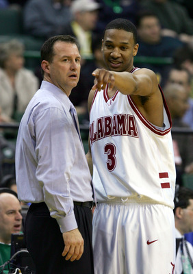 CLEVELAND,OH - MARCH 17:  Kennedy Winston, # 3, of the Alabama Crimson Tide talks with coach Mark Gottfried during thier game against the Milwaukee-Wisconsin Panthers during the first round of the 2005 NCAA Championship on March 17, 2005 at The Wolstein C