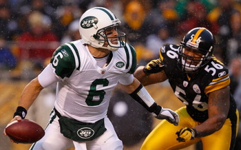 PITTSBURGH - DECEMBER 19:  Mark Sanchez #6 of the New York Jets is rushed by LaMarr Woodley #56 of the Pittsburgh Steelers during the game on December 19, 2010 at Heinz Field in Pittsburgh, Pennsylvania.  (Photo by Jared Wickerham/Getty Images)