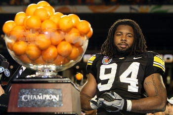 MIAMI GARDENS, FL - JANUARY 05:  Adrian Clayborn #94 of the Iowa Hawkeyes looks on as the Hawkeyes celebrate their 24-14 win against the Georgia Tech Yellow Jackets during the FedEx Orange Bowl at Land Shark Stadium on January 5, 2010 in Miami Gardens, Fl
