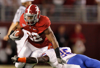 TUSCALOOSA, AL - OCTOBER 02:  Mark Ingram #22 of the Alabama Crimson Tide breaks a tackle by Ahmad Black #35 of the Florida Gators at Bryant-Denny Stadium on October 2, 2010 in Tuscaloosa, Alabama.  (Photo by Kevin C. Cox/Getty Images)