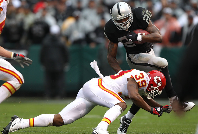 OAKLAND, CA - NOVEMBER 07:  Darren McFadden #20 of the Oakland Raiders is tackled by Brandon Carr #39 of the Kansas City Chiefs during an NFL game at Oakland-Alameda County Coliseum on November 7, 2010 in Oakland, California.  (Photo by Jed Jacobsohn/Gett