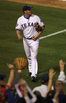 ARLINGTON, TX - OCTOBER 30:  Colby Lewis #48 of the Texas Rangers walks to the dugout in the eigth inning against the San Francisco Giants in Game Three of the 2010 MLB World Series at Rangers Ballpark in Arlington on October 30, 2010 in Arlington, Texas.