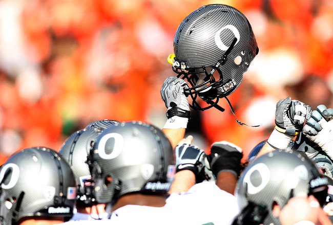 CORVALLIS, OR - DECEMBER 04: The Oregon Ducks hold their helmets high before the game against  the Oregon State Beavers during the 114th Civil War on December 4, 2010 at the Reser Stadium in Corvallis, Oregon.  (Photo by Jonathan Ferrey/Getty Images)