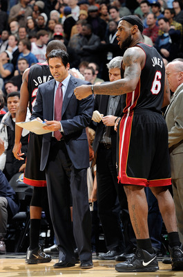 WASHINGTON, DC - DECEMBER 18:  Head coach Eric Spoelstra of the Miami Heat talks with LeBron James #6 during a timeout in the game against the Washington Wizards at the Verizon Center on December 18, 2010 in Washington, DC. NOTE TO USER: User expressly ac
