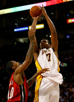 LOS ANGELES, CA - JANUARY 11:  Andrew Bynum #17 of the Los Angeles Lakers shoots over Udonis Haslem #40 of the Miami Heat in the fourth quarter at Staples Center on January 11, 2009 in Los Angeles, California. The Lakers defeated the Heat 108-105. NOTE TO