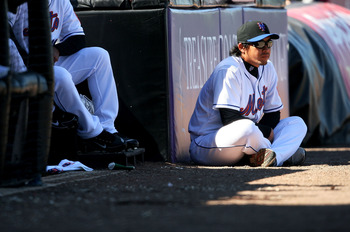 PORT ST. LUCIE, FL - MARCH 07:  Pitcher Ryota Igarashi #18 watches countryman and relief pitcher Hisanori Takahashi #47 of the New York Mets pitch against the Washington Nationals at Tradition Field on March 7, 2010 in Port St. Lucie, Florida.  (Photo by