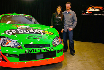 MOORESVILLE, NC - DECEMBER 17:  Danica Patrick (L), driver of the #7 GoDaddy.com Chevrolet poses with team owner Dale Earnhardt Jr. (R), at JR Motorsports on December 17, 2009 in Mooresville, North Carolina.  (Photo by Jason Smith/Getty Images)