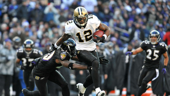 BALTIMORE, MD - DECEMBER 19:  Marques Colston #12 of the New Orleans Saints runs the ball while being defended by Ed Reed #20 of the Baltimore Ravens  at M&T Bank Stadium on December 19, 2010 in Baltimore, Maryland. The Ravens defeated the Saints 30-24. (