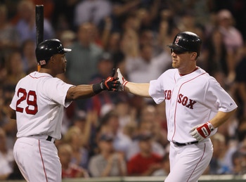 BOSTON - SEPTEMBER 22:  J.D. Drew #7 of the Boston Red Sox is congratulated by teammate Adrian Beltre #29 after Drew scored on a single from David Oritz in the sixth inning against the Baltimore Orioles on September 22, 2010 at Fenway Park in Boston, Mass