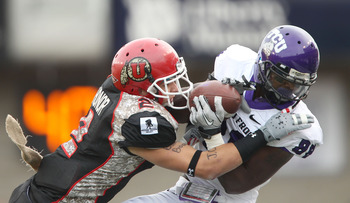 SALT LAKE CITY, UT - NOVEMBER 6: Brian Blechen #2 of the Utah Utes tackles Jimmy Young #88 of the TCU Horned Frogs during the second half of an NCAA Football game November 6, 2010 at Rice-Eccles Stadium in Salt Lake City, Utah. TCU Beat Utah 47-7.  (Photo