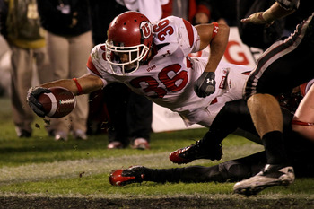 SAN DIEGO - NOVEMBER 20:  Running back Eddie Wide #36 of the Utah Utes reaches the ball over the goal line to score the winning touchdown on a one yard carry in the fourth quarter against the San Diego State Aztecs at Qualcomm Stadium on November 20, 2010