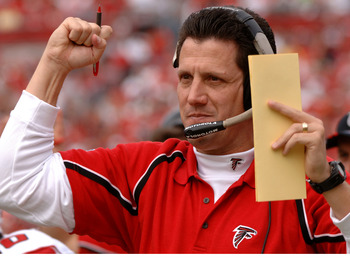 Atlanta Falcons offfensive coordinator  Greg Knapp cheers a touchdown against the Tampa Bay Buccaneers  December 24, 2005 in Tampa.  The Bucs defeated the Falcons 27 - 24 in overtime.  (Photo by Al Messerschmidt/Getty Images)