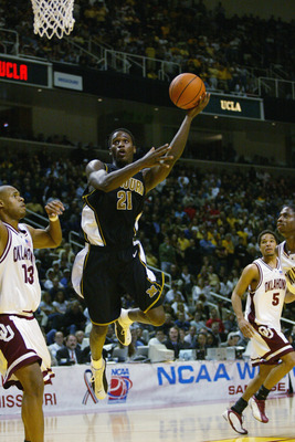 SAN JOSE, CA - MARCH 23:  Kareem Rush #21 of the Missouri Tigers goes to the basket during the West Regional Final of the 2002 NCAA Men's Basketball Tournament against the Oklahoma Sooners on March 23, 2002 at Compaq Center in San Jose, California.  The S
