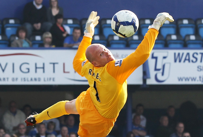 PORTSMOUTH, ENGLAND - APRIL 18: Goalkeeper Brad Friedel of Aston Villa makes a diving save during the Barclays Premier League match between Portsmouth and Aston Villa at Fratton Park on April 18, 2010 in Portsmouth, England.  (Photo by Phil Cole/Getty Ima
