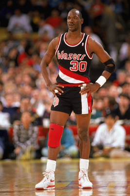 LOS ANGELES - 1990:  Terry Porter #30 of the Portland Trail Blazers rests during the 1989-1990 NBA season game against the Los Angeles Lakers at the Great Western Forum in Los Angeles, California.  (Photo by Ken Levine/Getty Images)