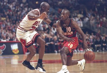 8 May 1997:  Guard Mookie Blaylock of the Atlanta Hawks tries to fend off guard Michael Jordan of the Chicago Bulls during a playoff game at the United Center in Chicago, Illinois.  The Hawks won the game 103-95. Mandatory Credit: Jonathan Daniel  /Allspo