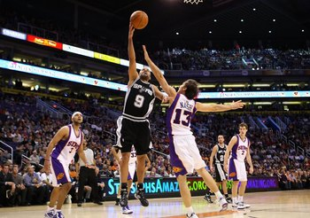 PHOENIX - DECEMBER 15:  Tony Parker #9 of the San Antonio Spurs lays up a shot during the NBA game against the Phoenix Suns at US Airways Center on December 15, 2009 in Phoenix, Arizona. The Suns defeated the Spurs 116-104. NOTE TO USER: User expressly ac