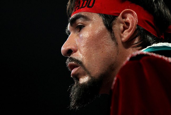 ARLINGTON, TX - NOVEMBER 13:  Antonio Margarito (black trunks) of Mexico looks on from his corner as he waits to fight Manny Pacquiao of the Philippines during their WBC World Super Welterweight Title bout at Cowboys Stadium on November 13, 2010 in Arling