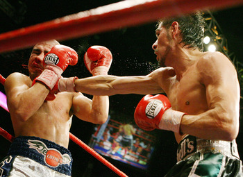 LAS VEGAS - JULY 26:  Antonio Margarito (R) hits Miguel Cotto during their WBA welterweight title fight at the MGM Grand Garden Arena July 26, 2008 in Las Vegas, Nevada. Margarito won by TKO in the 11th round.  (Photo by Ethan Miller/Getty Images)
