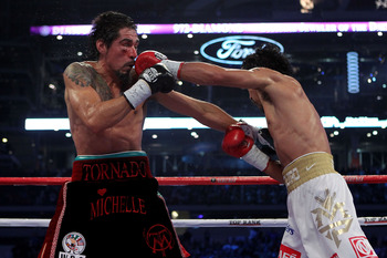 ARLINGTON, TX - NOVEMBER 13:  Manny Pacquiao (white trunks) of the Philippines lands a punch against Antonio Margarito (black trunks) of Mexico during their WBC World Super Welterweight Title bout at Cowboys Stadium on November 13, 2010 in Arlington, Texa