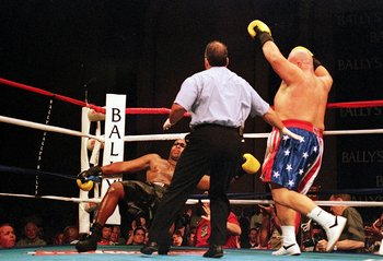 16 Jul 1999: Butterbean throws a punch which knocks down Jackie Bearo at Bally's Park Place in Atlantic City, New Jersey. Mandatory Credit: Vincent Laforet  /Allsport