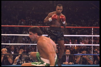 19 Aug 1995:  Boxer Mike Tyson sends Peter McNeeley crashing to the mat at the MGM Grand in Las Vegas, Nevada, in Tyson''s first bout since emerging from prison.  Tyson defeated McNeeley by knockout 1:29 into the first round.  Mandatory Credit:  Holly Ste