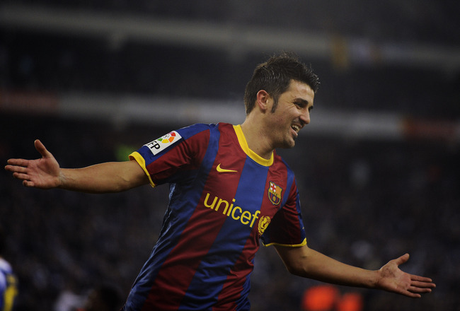 BARCELONA, SPAIN - DECEMBER 18:  David Villa of Barcelona celebrates after scoring his fifth team's goal during the La Liga match between Espanyol and Barcelona at Cornella - El Prat stadium on December 18, 2010 in Barcelona, Spain.  (Photo by David Ramos