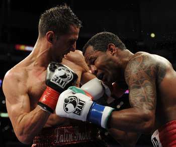LOS ANGELES, CA - SEPTEMBER 18:  Sergio Mora hits Shane Mosley during the 10th round of the Middleweight bout at Staples Center on September 18, 2010 in Los Angeles, California.  The fight ended in a draw.  (Photo by Harry How/Getty Images)